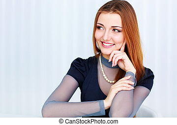 Portrait of a beautiful cheerful woman looking right at copyspace