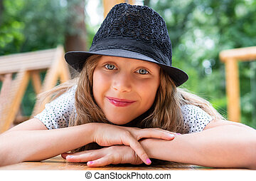 portrait of a beautiful child in hat
