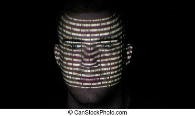 Portrait of a beautiful computer programmer hacking white binary code characters are reflected on his face