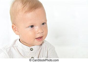 Portrait of a beautiful cute baby boy in studio
