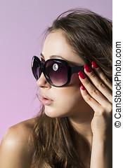 Beautiful fashion model wearing sunglasses