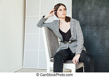 Portrait of a beautiful fashionable brunette woman in business style