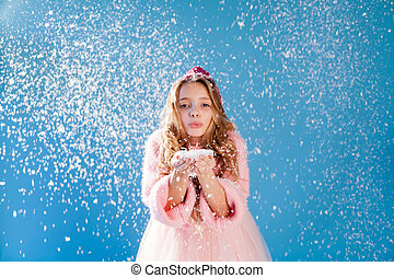 portrait of a beautiful fashionable girl in a winter warm cap with snow