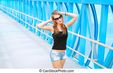 Portrait of a beautiful fashionable girl in sunglasses