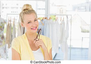 Portrait of a beautiful female fashion designer