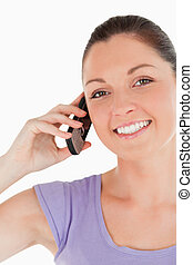 Portrait of a beautiful female on the phone while standing