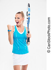 Portrait of a beautiful female tennis player screaming