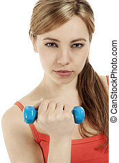 portrait of a beautiful fitness woman with a dumbbell on white background