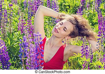 Portrait of a beautiful girl in a field