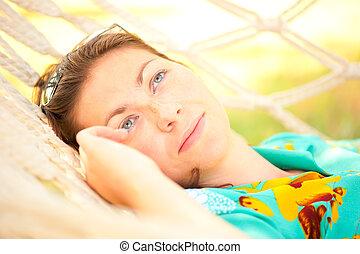 portrait of a beautiful girl in a hammock