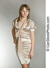 beautiful girl in a smart dress