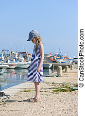 Portrait of a beautiful girl in harbor