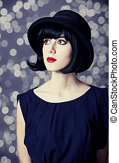 Portrait of a beautiful girl in hat.