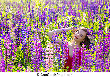 Portrait of a beautiful girl in lupines