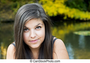 Portrait of a beautiful girl in outdoors