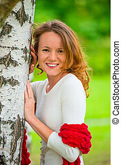 portrait of a beautiful girl in spring park near birch