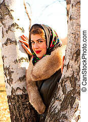 portrait of a beautiful girl in the birches