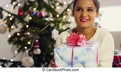 Portrait of a beautiful girl in the Christmas tree