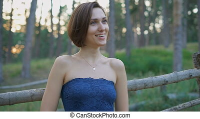 Portrait of a beautiful girl in the woods or park.