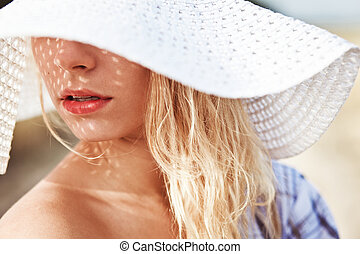 portrait of a beautiful girl in the hat