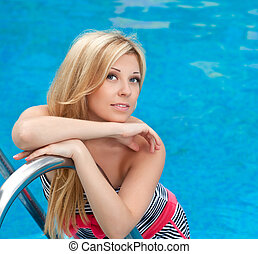 portrait of a beautiful girl in the pool