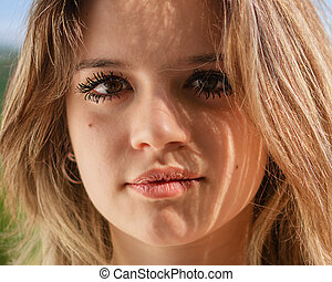 Portrait of a beautiful girl looking at camera