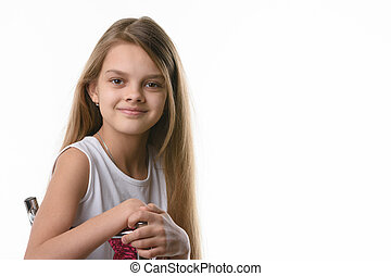 Portrait of a beautiful girl of ten years of European appearance