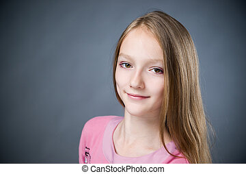 Portrait of a beautiful girl on a gray background