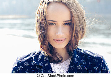 portrait of a beautiful girl on a windy day. Art portrait of a beautiful lonely girl