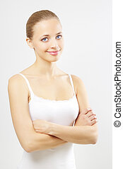 Portrait of a beautiful girl on gray background