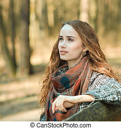 portrait of a beautiful girl outdoors in spring