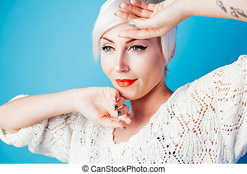 Portrait of a beautiful girl posing on a white background