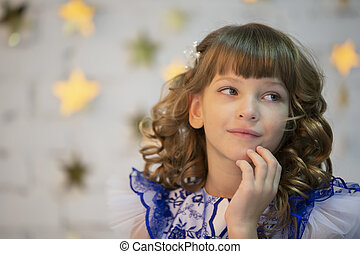 Portrait of a beautiful girl. Seven-year-old child. Primary school girl model