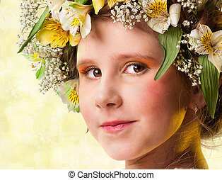 Portrait of a beautiful girl wearing flowers hat.