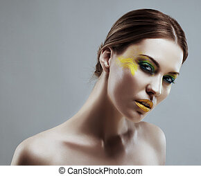 Portrait of a beautiful girl with a color make-up