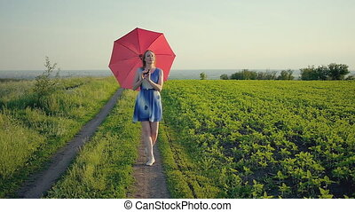 portrait of a beautiful girl with a red umbrella in the sunset smiling emotions green grass field smiling girl dancing laughing spinning golden hour sunset