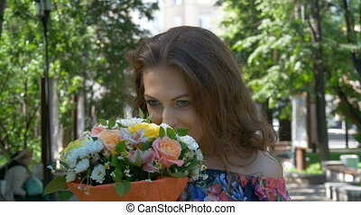 Portrait of a beautiful girl with flowers. close-up