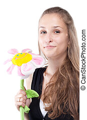 Portrait of a beautiful girl with long hair plush flower