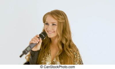 Portrait of a beautiful girl with long hair. Record a music video. close-up