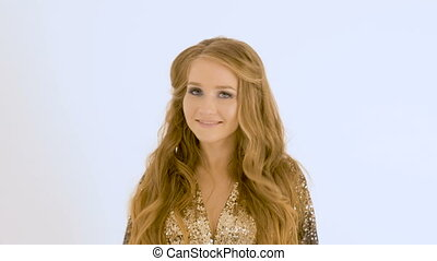 Portrait of a beautiful girl with long hair. She sings in the studio on a white background.