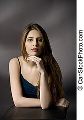 Portrait of a beautiful girl with long hair.