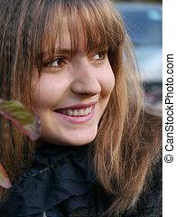 Portrait of a beautiful, happy girl, closeup.