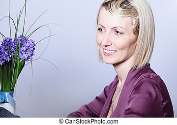 Portrait of a beautiful happy woman with hairstyle