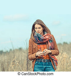 portrait of a beautiful hipster girl smoking outdoors