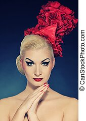Portrait of a beautiful lady in red hat