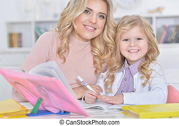 Portrait of a beautiful little cute girl with mother
