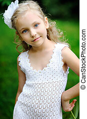portrait of a beautiful little girl in the summer