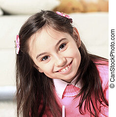 portrait of a beautiful little girl on the background of...