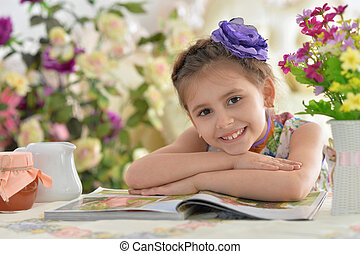 little girl with magazine
