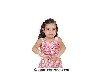 portrait of a beautiful little girl with thumb down isolated on white background